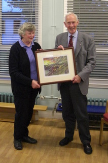 Anne Masson presents George Swapp with a picture of Catterline